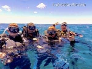Bakasyon at Scuba Diving sa Coral Reefs ng Pilipinas - A group of people swimming in a body of water - Sea