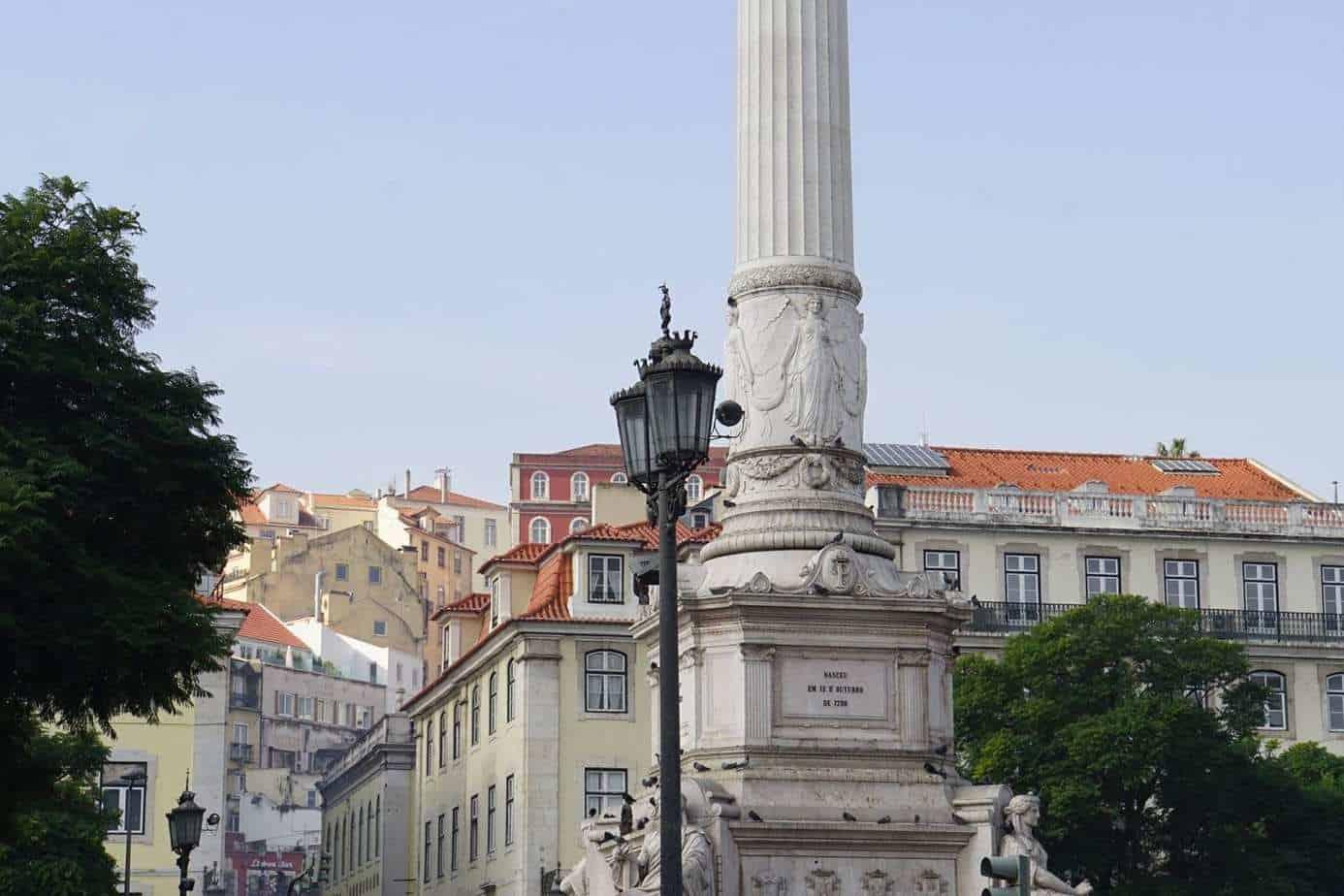ExploreTraveler Presents: Exploring Lisbon Portugal Part 1 - A small clock tower in front of a building - Lisbon