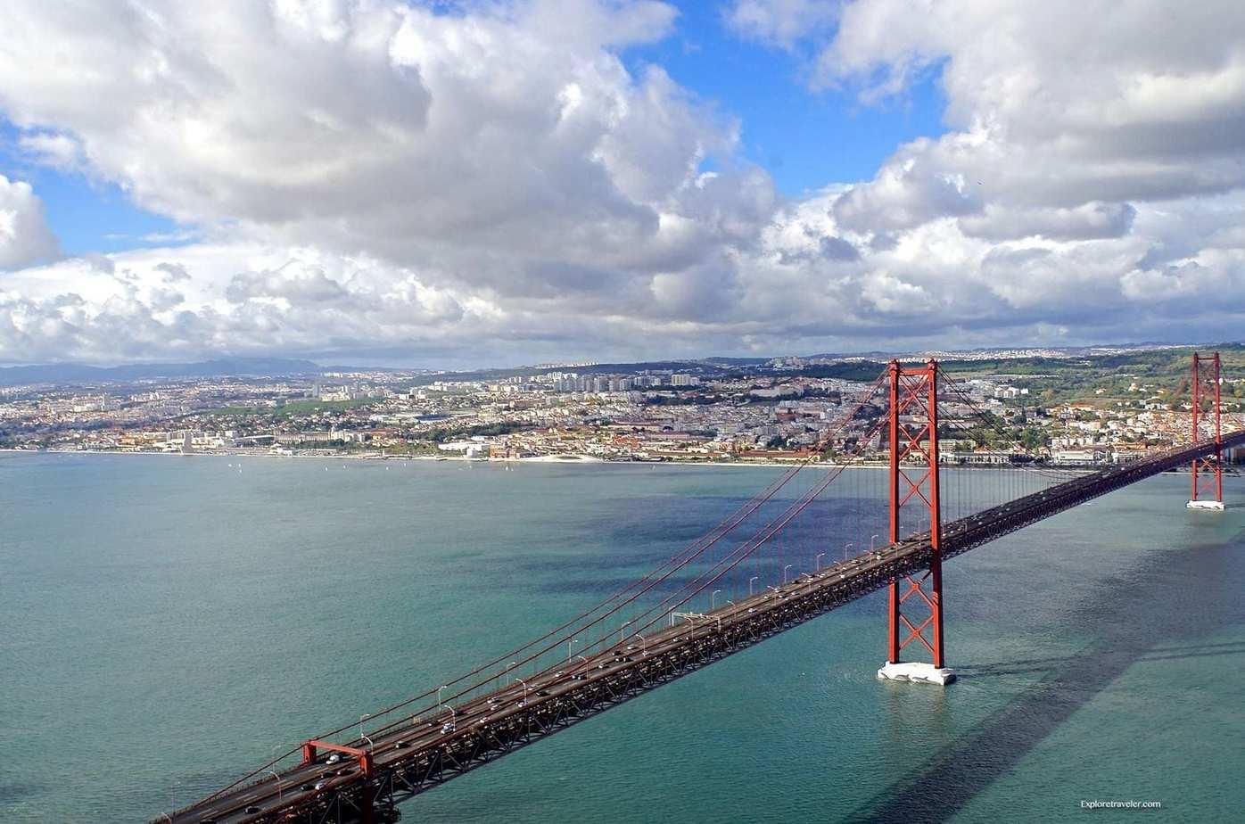 ExploreTraveler Presents: Exploring Lisbon Portugal Part 1 - A bridge over a body of water - Ponte 25 de Abril