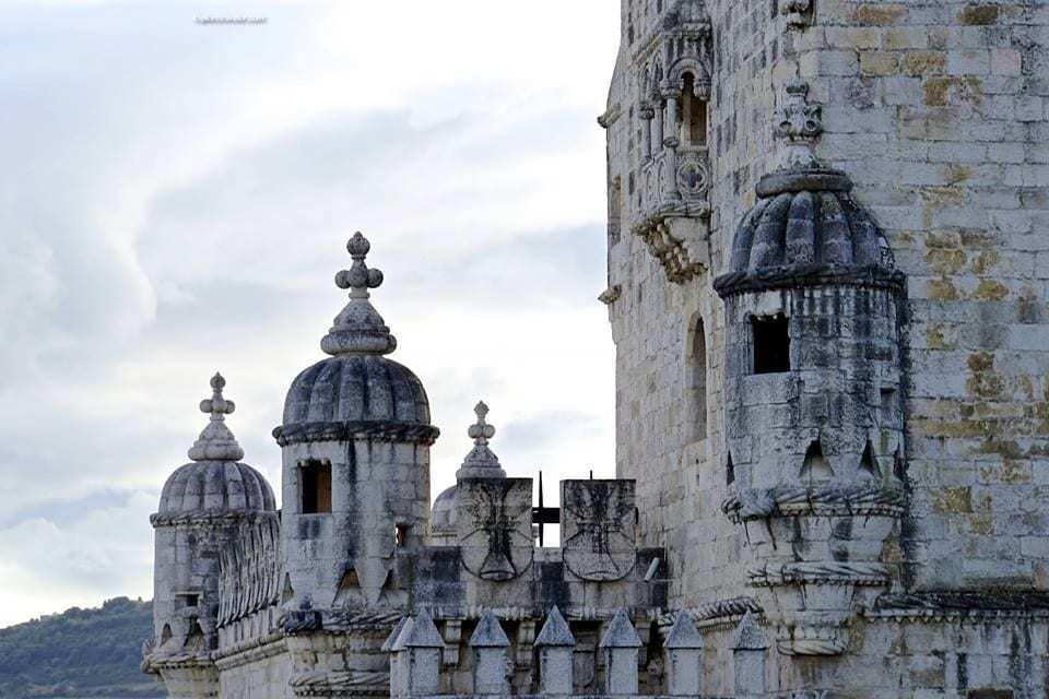 ExploreTraveler Presents: Lisbon Portugal A Photo Tour Part 1 - A group of people standing in front of a building - Belém Tower