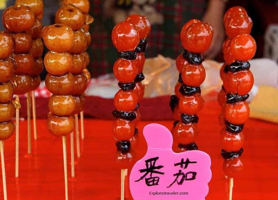 "A Taiwanese ""Little Eats"" Food Adventure - Food on a table - Tanghulu"
