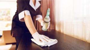 housekeeper-cleaning-room