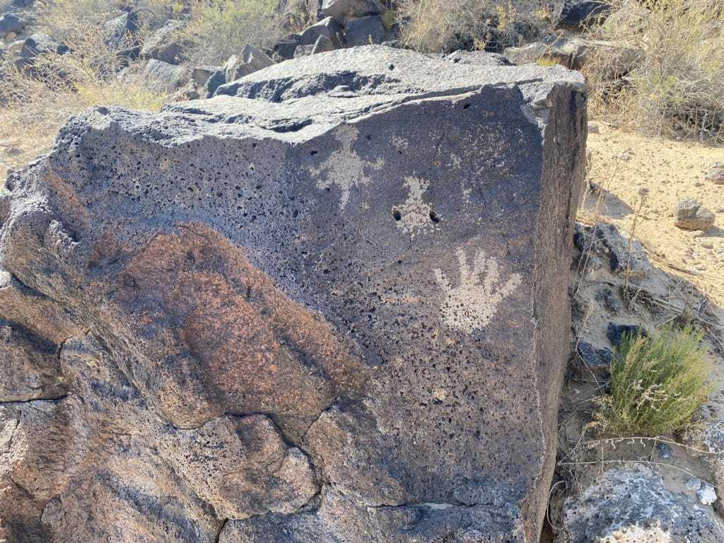 Hands and animals of Petroglyth Piedras Marcadas Canyon Trail